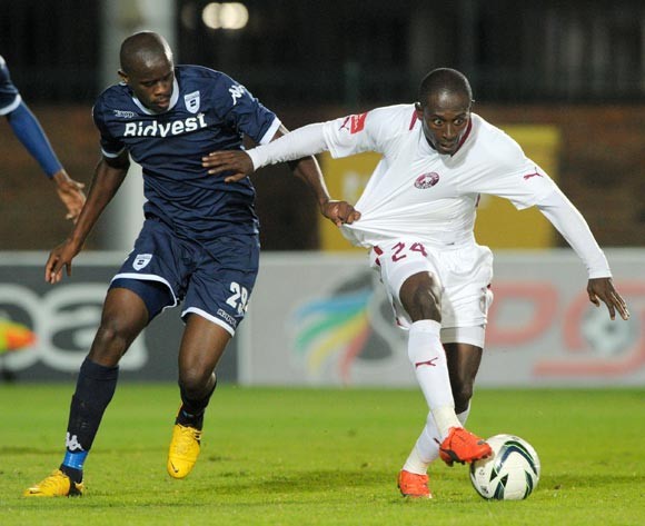 Felix Obada of Moroka Swallows battles with Kwanda Mngonyama of Bidvest Wits during the Absa Premiership 2013/14 match between Bidvest Wits and Moroka Swallows at Bidvest Stadium in Johannesburg on the 16 April 2014