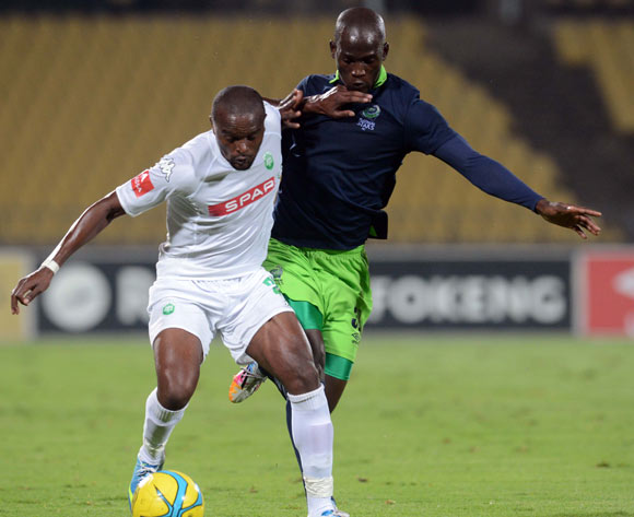 Bonginkosi Macala of AmaZulu battles with Siphelele Mthembu of Platinum Stars during the Absa Premiership match between Platinum Stars and AmaZulu on the 16 of April 2014 at Royal Bafokeng Stadium
