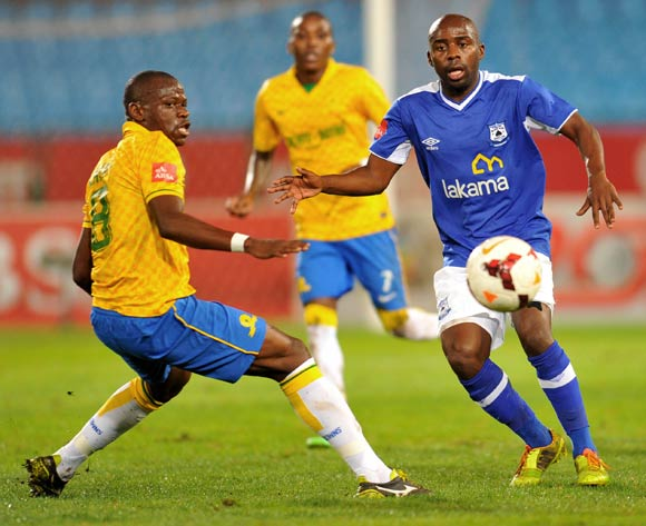 Sandile Zuke of Black Aces challenged by Hlompho Kekana of Mamelodi Sundowns during the Absa Premiership football match between Mamelodi Sundowns and Black Aces at the Loftus Stadium, Pretoria on 16 April 2014