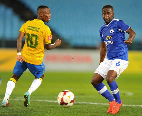 Clifford Ngobeni of Black Aces challenged by Teko Modise of Mamelodi Sundowns during the Absa Premiership football match between Mamelodi Sundowns and Black Aces at the Loftus Stadium, Pretoria on 16 April 2014