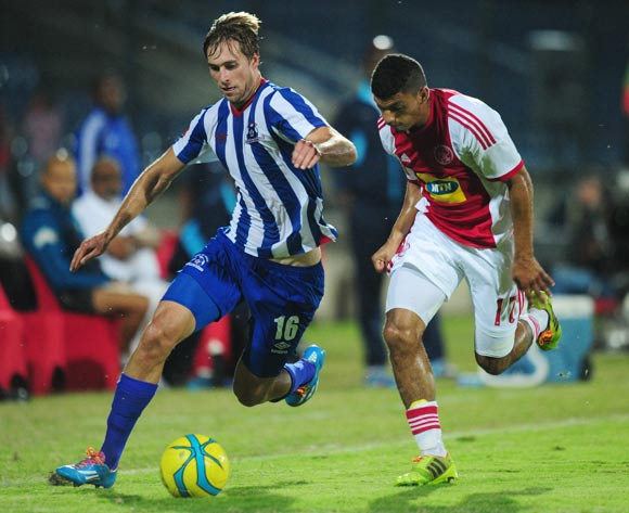 Rheece Evans of Maritzburg United battles Toriq Losper of Ajax Cape Town during the Absa Premiership 2013/14 football match between Maritzburg United and Ajax Cape Town at the Harry Gwala Stadium in Durban , Kwa-Zulu Natal on the 18th of April 2014
