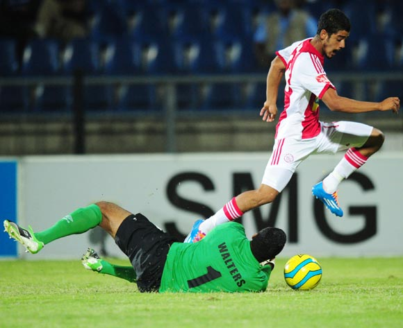 Abbubaker Mobara of Ajax Cape Town and Walters Shuaib of Maritzburg United during the Absa Premiership 2013/14 football match between Maritzburg United and Ajax Cape Town at the Harry Gwala Stadium in Durban , Kwa-Zulu Natal on the 18th of April 2014