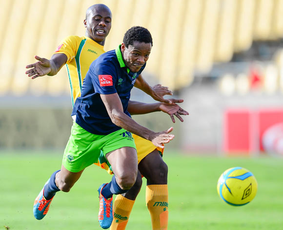 Bongi Ntuli of Golden Arrows and Thabiso Semenya of Platinum Stars during the Absa Premiership match between Platinum Stars and Golden Arrows at the Royal Bafokeng Stadium in Rustenburg, on April 19, 2014