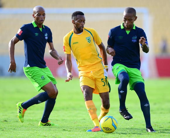 Manti Moholo of Golden Arrows and Vuyu Mere and Solomon Mathe of Platinum Stars during the Absa Premiership match between Platinum Stars and Golden Arrows at the Royal Bafokeng Stadium in Rustenburg, on April 19, 2014