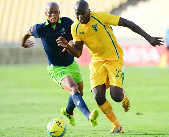 Bongi Ntuli of Golden Arrows and Solomon Mathe of Platinum Stars during the Absa Premiership match between Platinum Stars and Golden Arrows at the Royal Bafokeng Stadium in Rustenburg, on April 19, 2014