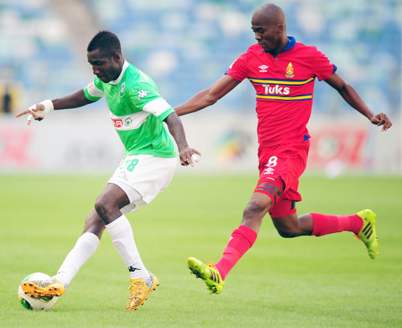 Goodman Dlamini of AmaZulu and Mpho Matsi of University Pretoria during the Absa Premiership 2013/14 football match between AmaZulu and University of Pretoria at the Moses Mabhida Stadium in Durban , Kwa-Zulu Natal on the 20th of April 2014