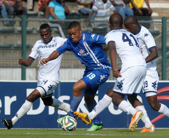 Dino Ndlovu of Supersport United battles with Onismor Bhasera of Bidvest Wits during the Absa Premiership 2013/14 match between Supersport United and Bidvest Wits at Lucas Moripe Stadium in Attridgeville on the 19 April 2014