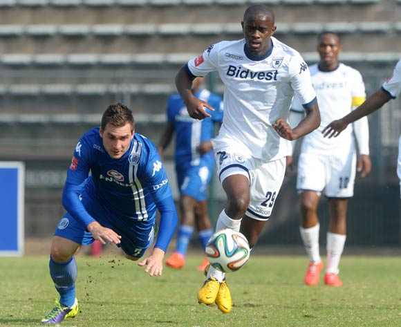 Bradley Grobler of Supersport United fouled by Kwanda Mngonyama of Bidvest Wits during the Absa Premiership 2013/14 match between Supersport United and Bidvest Wits at Lucas Moripe Stadium in Attridgeville on the 19 April 2014