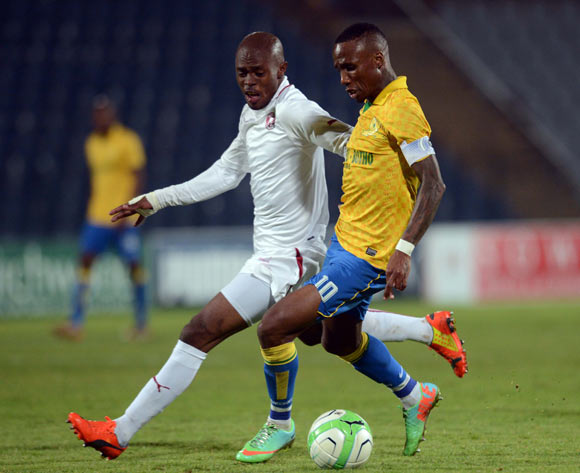 Teko Modise of Mamelodi Sundows battles with Asavela Mbekile of Moroka Swallows during the Absa Premiership match between Moroka Swallows and Mamelodi Sundowns on the 19 of April 2014 at Dobsonville Stadium
