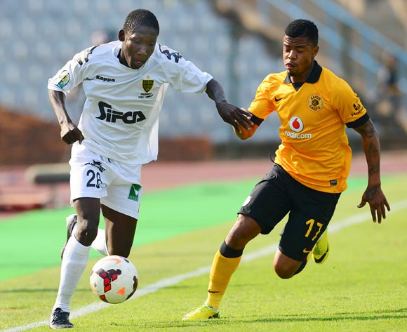 Moustapha Sakanoko of ASEC Mimosas and George Lebese of Kaizer Chiefs during the 2014 CAF Confederations Cup football match between Kaizer Chiefs and ASEC Mimosas at Dobsonville Stadium, in Soweto, South Africa on April 20, 2014