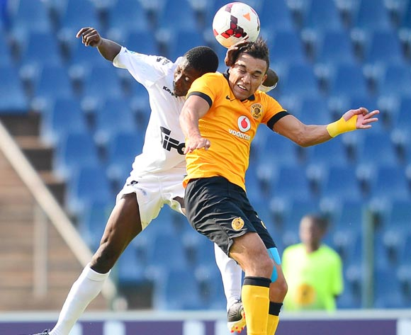 Matthew Rusike of Kaizer Chiefs and Moustapha Sakanoko of ASEC Mimosas during the 2014 CAF Confederations Cup football match between Kaizer Chiefs and ASEC Mimosas at Dobsonville Stadium, in Soweto, South Africa on April 20, 2014