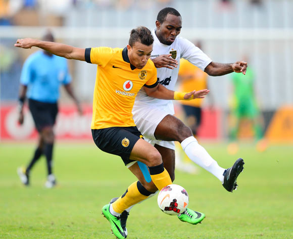 Matthew Rusike of Kaizer Chiefs and Michel Mvondo of ASEC Mimosas during the 2014 CAF Confederations Cup football match between Kaizer Chiefs and ASEC Mimosas at Dobsonville Stadium, in Soweto, South Africa on April 20, 2014