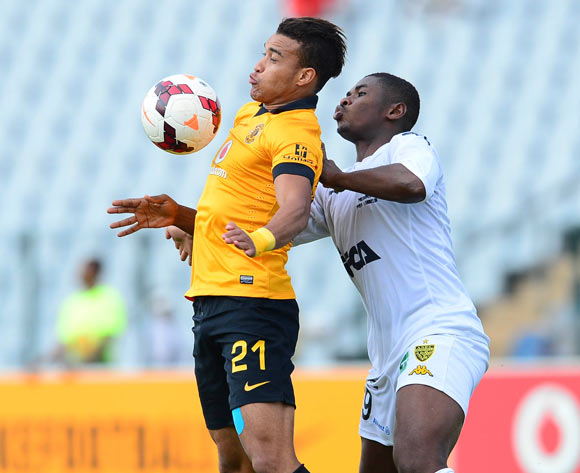 Matthew Rusike of Kaizer Chiefs and Nabi Ibrahim Kone of ASEC Mimosas during the 2014 CAF Confederations Cup football match between Kaizer Chiefs and ASEC Mimosas at Dobsonville Stadium, in Soweto, South Africa on April 20, 2014