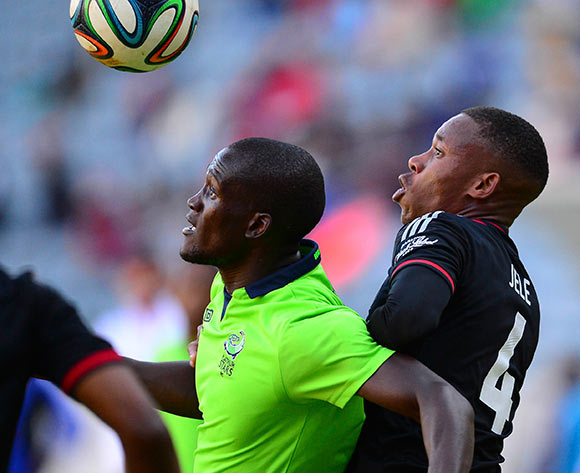Siphelele Mthembu of Platinum Stars and Happy Jele of Orlando Pirates during the 2014 Absa Premiership football match between Orlando Pirates and Platinum Stars at Orlando Stadium, in Soweto, South Africa on April 26, 2014