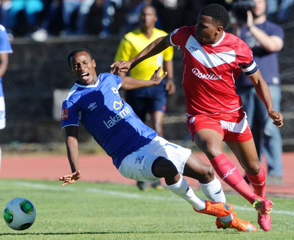 Themba Zwane of Black Aces fouled by Paulus Masehe of Free State Stars during the Absa Premiership 2013/14 match between Free State Stars and Black Aces at Goble Park in Bethlehem on the 26 April 2014