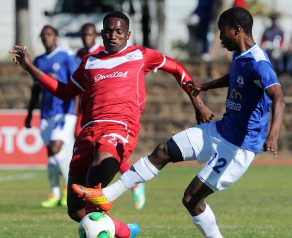 Moeketsi Sekola of Free State Stars challenged by Themba Zwane of Black Aces during the Absa Premiership 2013/14 match between Free State Stars and Black Aces at Goble Park in Bethlehem on the 26 April 2014