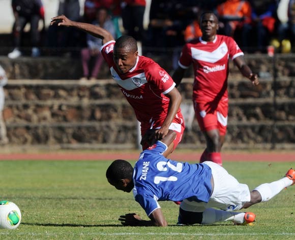 Themba Zwane of Black Aces fouled by Jurie Basie of Free State Stars during the Absa Premiership 2013/14 match between Free State Stars and Black Aces at Goble Park in Bethlehem on the 26 April 2014