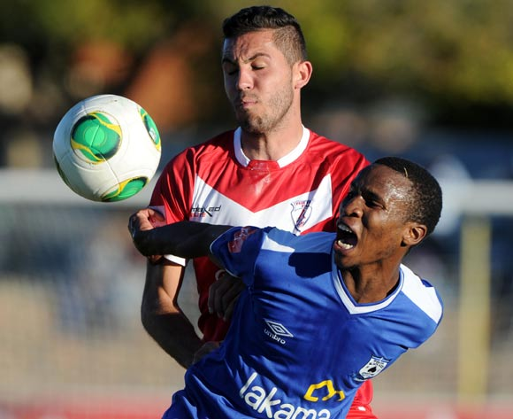 Themba Zwane of Black Aces battles with Daniel Cardoso of Free State Stars during the Absa Premiership 2013/14 match between Free State Stars and Black Aces at Goble Park in Bethlehem on the 26 April 2014