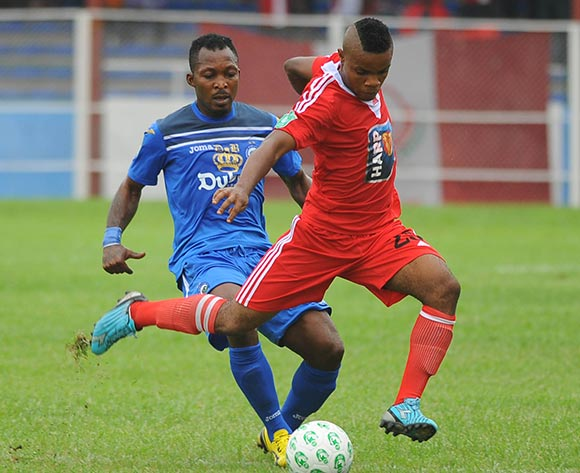 Ugwu Uwadiegwu of Enyimba challenges Chinedu Sunday of Rangers during the Glo Nigeria Premier League 2014  match between Enyimba and Rangers on March 16, 2014 at Enyimba Stadium, Aba, Abia state