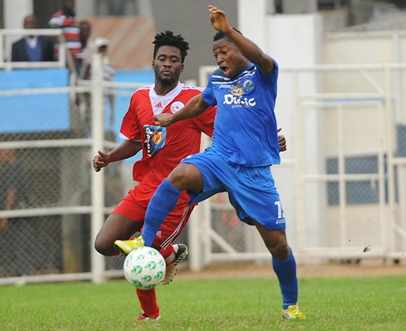 Pape Ousmane Sane of Rangers challenges Sibi Gwar of Enyimba during the Glo Nigeria Premier League 2014  match between Enyimba and Rangers on March 16, 2014 at Enyimba Stadium, Aba, Abia state