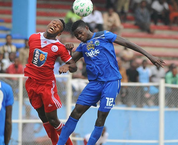 Ugonna Uzochukwu of Rangers in aerial challenge with Rasheed Olabiyi of Enyimba during the Glo Nigeria Premier League 2014  match between Enyimba and Rangers on March 16, 2014 at Enyimba Stadium, Aba, Abia state