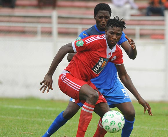 Ighodalo Osagona of Rangers is challenged by Semiu Liadi of Enyimba during the Glo Nigeria Premier League 2014  match between Enyimba and Rangers on March 16, 2014 at Enyimba Stadium, Aba, Abia state