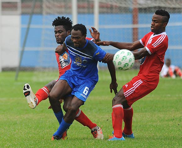 Ayo Saka of Enyimba is challenged by Pape Ousmane Sane and Ugonna Uzochukwu of Rangers during the Glo Nigeria Premier League 2014  match between Enyimba and Rangers on March 16, 2014 at Enyimba Stadium, Aba, Abia state