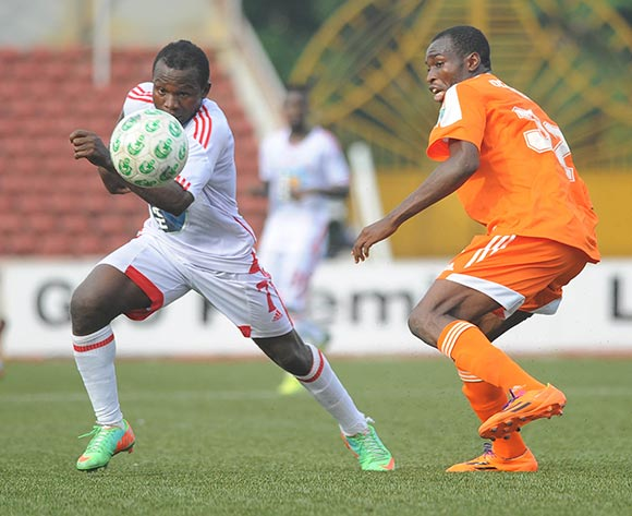Ejike Uzoenyi of Rangers is challenged by Ebenezer Odunlanmi of Sunshine Stars during the Glo Nigeria Premier League 2014  match between Rangers and Sunshine Stars on April 6, 2014 at Nnamdi Azikiwe Stadium, Enugu, Enugu state