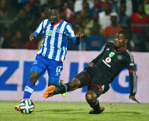 Frank Sarfo Gyamfi of Maritzburg United tackled by Rooi Mahamutsa of Orlando Pirates  during the 2013/14 Nedbank Cup semi final match between Maritzburg United and Orlando Pirates at the Harry Gwala Stadium, Pietermaritzburg on 3 May 2014