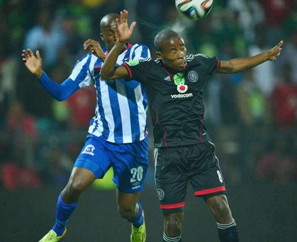 Thabo Matlaba of Orlando Pirates  challenged by Bongolethu Jayiya of Maritzburg United  during the 2013/14 Nedbank Cup semi final match between Maritzburg United and Orlando Pirates at the Harry Gwala Stadium, Pietermaritzburg on 3 May 2014