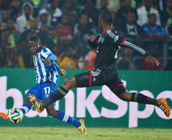 Frank Sarfo Gyamfi of Maritzburg United crosses ball past Rooi Mahamutsa of Orlando Pirates  during the 2013/14 Nedbank Cup semi final match between Maritzburg United and Orlando Pirates at the Harry Gwala Stadium, Pietermaritzburg on 3 May 2014