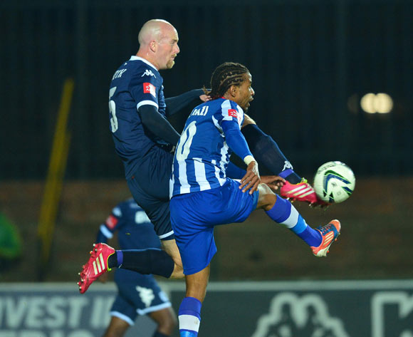 Matthew Booth of Bidvest Wits clear ball from Nhlanhla Vilakazi of Maritzburg United during the 2013/14 Absa Premiership football match between Bidvest Wits and Maritzburg United at Bidvest  Stadium, Johannesburg on 6 May 2014