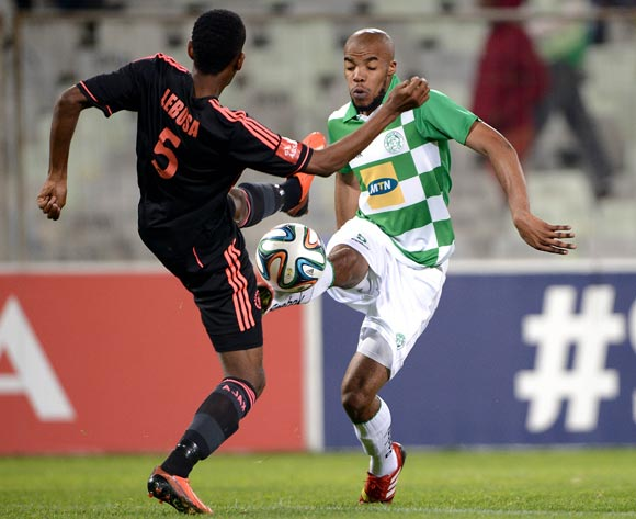 Wandisile Letlabika of Bloemfontein Celtic and Mosa Lebusa of Ajax Cape Town during the Absa Premiership match between Bloemfontein Celtic FC and Ajax at the Free State Stadium on 6 May 2014