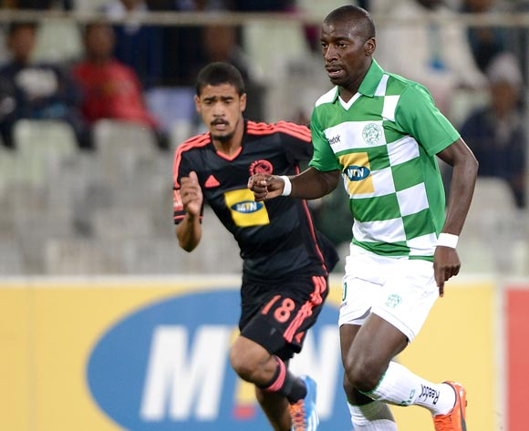 Musa Nyatama of Bloemfontein Celtic and Abbubaker Mobara of Ajax Cape Town during the Absa Premiership match between Bloemfontein Celtic FC and Ajax at the Free State Stadium on 6 May 2014