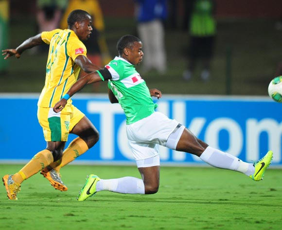 Tamsanqa Teyise of AmaZulu and Bongi Ntuli of Golden Arrows during the Absa Premiership 2013/14 football match between AmaZulu and Golden Arrows at the Princess Magogo Stadium in Durban , Kwa-Zulu Natal on the 6th of May 2014