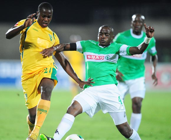 Msekeli Mvalo of AmaZulu battles Bongi Ntuli of Golden Arrows during the Absa Premiership 2013/14 football match between AmaZulu and Golden Arrows at the Princess Magogo Stadium in Durban , Kwa-Zulu Natal on the 6th of May 2014