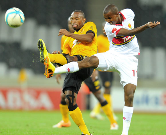 Thabo Mosadi of University Pretoria challenged by Bernard Parker of Kaizer Chiefs during the Absa Premiership football match between University of Pretoria and Kaizer Chiefs at the Mbombela Stadium, on 06 May 2014