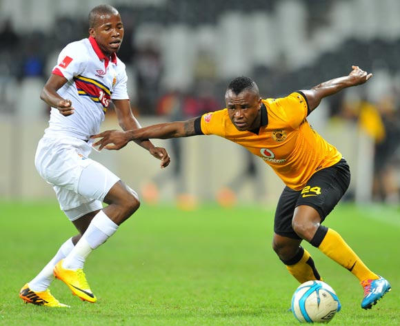 Tsepo Masilela of Kaizer Chiefs challenged by Thabo Mosadi of University Pretoria during the Absa Premiership football match between University of Pretoria and Kaizer Chiefs at the Mbombela Stadium, on 06 May 2014