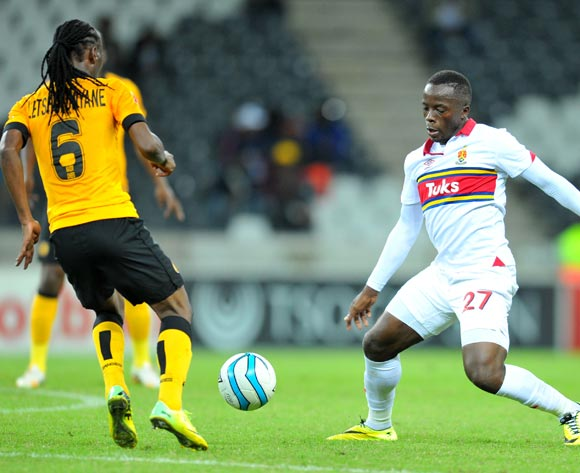 Atusaye Nyondo of University Pretoria challenged by Reneilwe Letsholonyane of Kaizer Chiefs during the Absa Premiership football match between University of Pretoria and Kaizer Chiefs at the Mbombela Stadium, on 06 May 2014