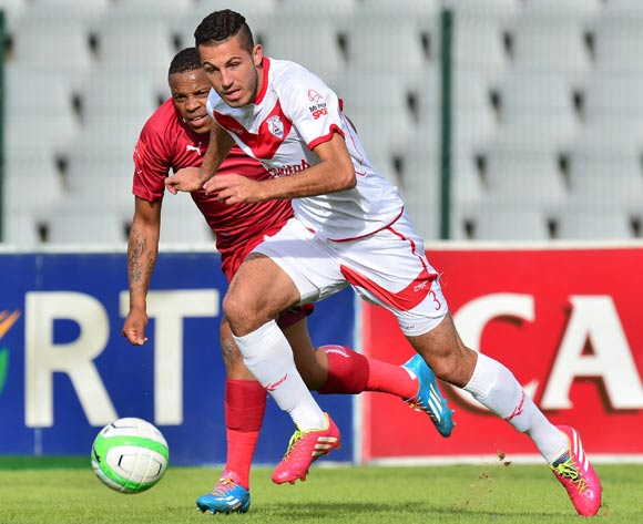 Daniel Cardoso of Free State Stars and Edward Manqele of Moroka Swallows during the 2013/14 Absa Premiership football match between Moroka Swallows and Free State Stars at Dobsonville Stadium, Soweto on 10 May 2014