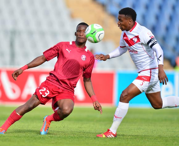 Tshwarelo Bereng of Moroka Swallows and Paulus Masehe of Free State Stars during the 2013/14 Absa Premiership football match between Moroka Swallows and Free State Stars at Dobsonville Stadium, Soweto on 10 May 2014