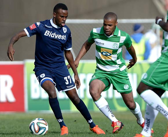 Jabulani Shongwe of Bidvest Wits and Wandisile Letlabike of Bloemfontein Celtic during the Absa Premiership match between Bloemfontein Celtic FC and Bidvest Wits at the Kaizer Sebothelo Stadium on 10 May 2014