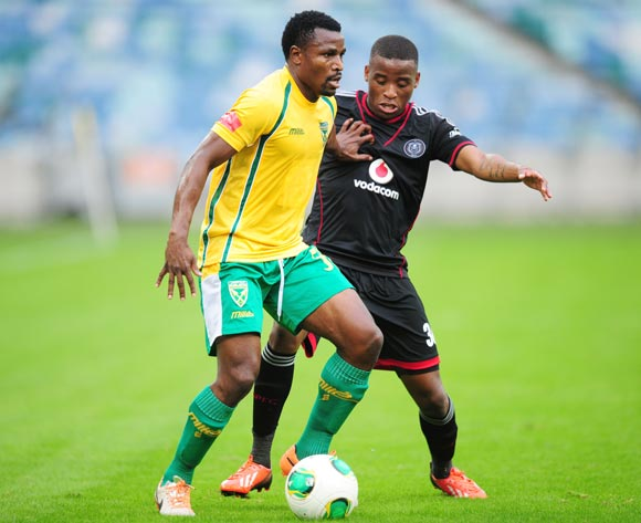 Christopher Katongo of Golden Arrows battles Mbongeni Gumede of Orlando Pirates during the Absa Premiership 2013/14 football match between Golden Arrows and Orlando Pirates at the Moses Mabhida Stadium in Durban , Kwa-Zulu Natal on the 10th of May 2014