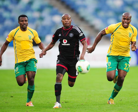 Thabo Matlaba (m) of Orlando Pirates battles Bongi Ntuli ® and Christopher Katongo (l) of Golden Arrowsduring the Absa Premiership 2013/14 football match between Golden Arrows and Orlando Pirates at the Moses Mabhida Stadium in Durban , Kwa-Zulu Natal on the 10th of May 2014