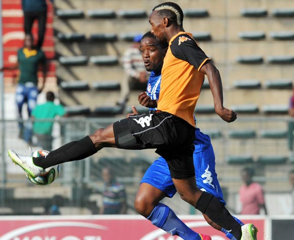 Thabo Rakhale of Polokwane City challenged by Thabo September of Supersport United during the Absa Premiership football match between SuperSport United and Polokwane City at the Lucas Moripe Stadium, Pretoria on 10 May 2013