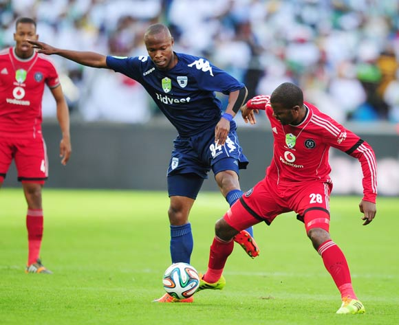 Letladi Madubanya  of Bidvest Wits battles Rooi Mahamutsa of Orlando Pirates during the 2014 Nedbank Cup Final football match between Orlando Pirates and Bidvest Wits at the Moses Mabhida Stadium in Durban on the 17th of  May 2014