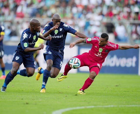 Kermit Erasmus (l) of Orlando Pirates battles Sboniso Gumede (r) with Kwanda Mngonyama(m) of Bidvest Wits during the 2014 Nedbank Cup Final football match between Orlando Pirates and Bidvest Wits at the Moses Mabhida Stadium in Durban on the 17th of  May 2014