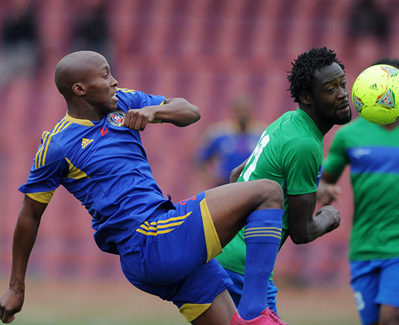 Kei Kamara of Sierra Leone battles with Sifiso Mabila of Swaziland during the African Cup of Nations Qualifiers match between Swaziland and Sierra Leone in Somhlolo Stadium,  Mbabane on the 18 May 2014