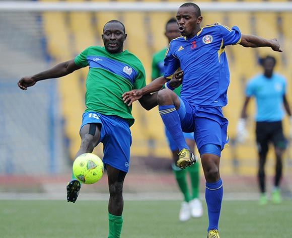 Rodney Strasser of Sierra Leone battles with Sifiso Nkambule of Swaziland battles with  during the African Cup of Nations Qualifiers match between Swaziland and Sierra Leone in Somhlolo Stadium,  Mbabane on the 18 May 2014