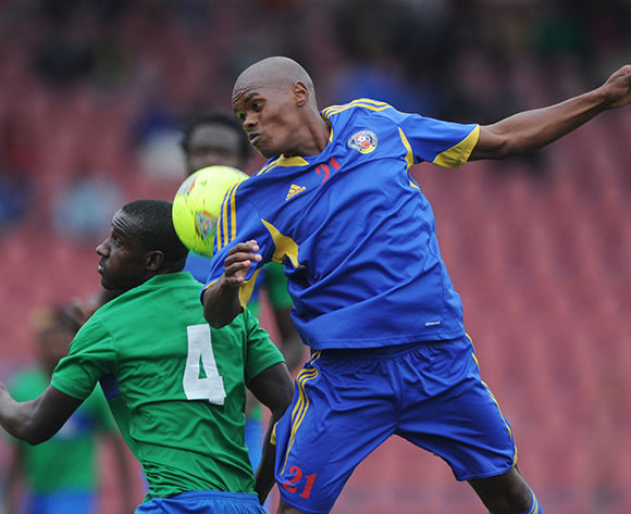 Ibrahim Koroma of Sierra Leone battles with Skhumbuzo Ntimane of Swaziland during the African Cup of Nations Qualifiers match between Swaziland and Sierra Leone in Somhlolo Stadium,  Mbabane on the 18 May 2014